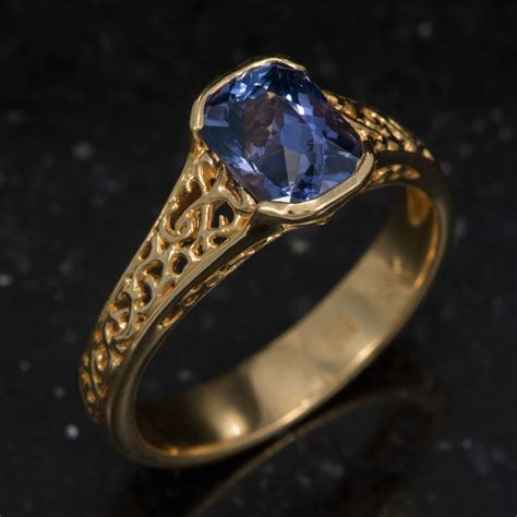 Blue Cushion Cut Sapphire Ring in 18K Yellow Gold Product